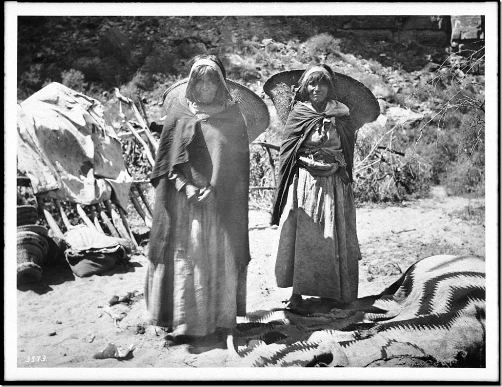 Two_Havasupai_Indian_women_with_-Kathaks-_on_their_backs,_ca.1900_(CHS-3373)
