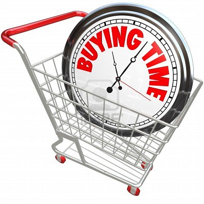 11107564-a-white-clock-in-a-shopping-cart-with-the-words-buying-time-illustrating-the-saying-about-stalling-w